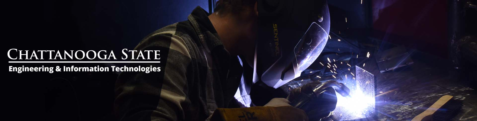 photo of person welding