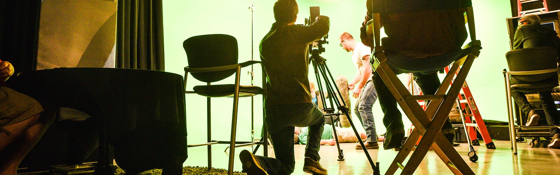 Film students using camera equipment.