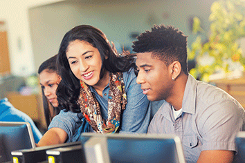 3 students around a computer