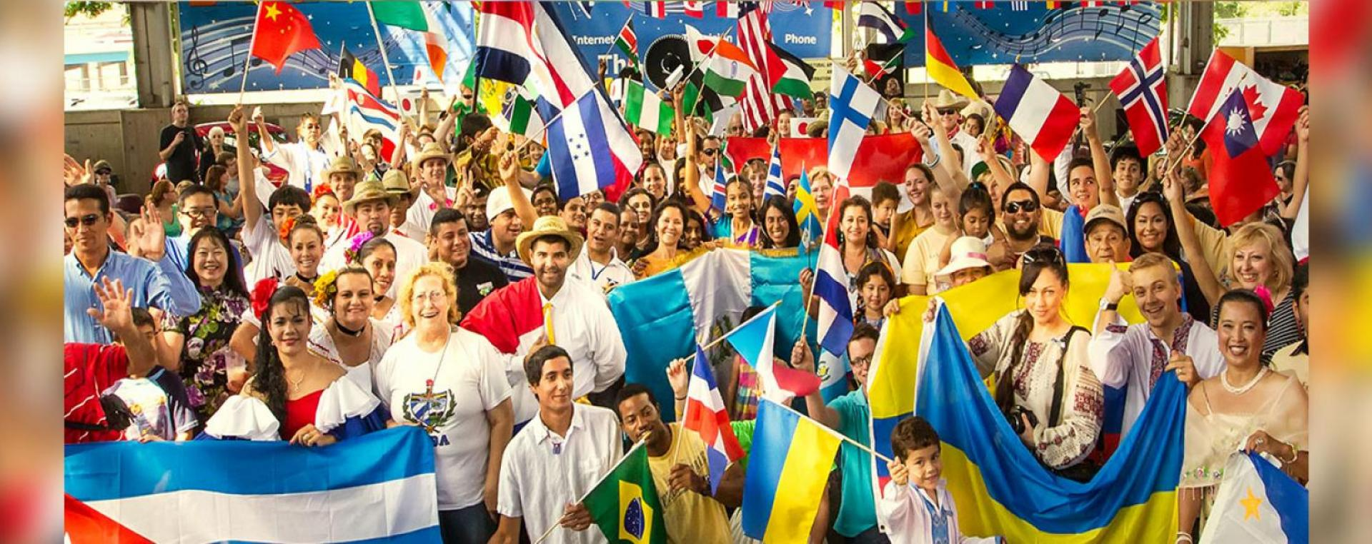 Culture Fest attendees parading flags from various countries.