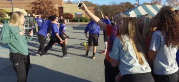 Photo of a group of students holding poses for a Mannequin Challenge