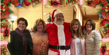 Photo of employees Nancy Patterson, Tammy Sawyers Chef Stan as Santa, Suzanne Harris and Brenda Ingram for a holiday themed image