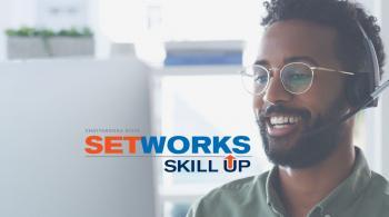 man at computer, setworks logo