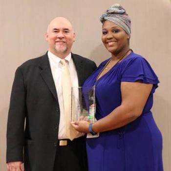 delnita evans with apca award