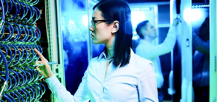 female examines computer system unit