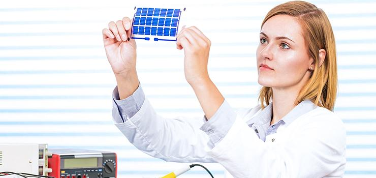 Technician observes an electronic part