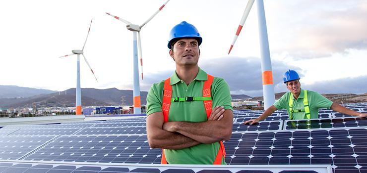 two men stand amongst solar panels